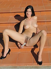 Liliana plays with her hairy pussy outside