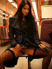 Stunning young babe flashing her sweet tits in the metro