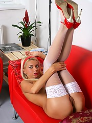Stunning blonde beauty in stockings showing her sweet body