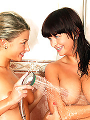 Two wet dripping teenagers toying each other in the shower