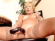 Older woman stimulates her swollen clitoris with a big vibrator
