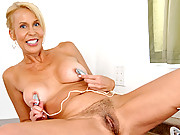Busty Anilos cougar uses a vibrating egg on her nipples and pussy