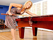 Leggy Anilos lady teases her clit with a vibe on the pool table