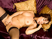 Sensual cougar in stockings masturbates on her couch