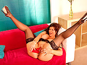Gilly stuffs her thick cougar pussy with the rabbit toy