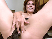 Sexy housewife gets off on stuffing her mature pussy with panties