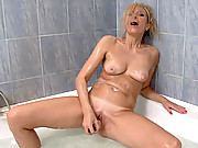 Blue eyed Anilos Olga fucks herself in the shower with a sex toy