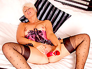 Hot cougar in lingerie stuffs her twat with a vibrator