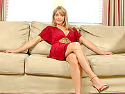 Sandy blonde haired cougar masturbates with a long vibrator