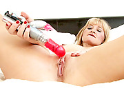 Sexy blonde cougar in red lipstick fucks her pussy with the rabbit