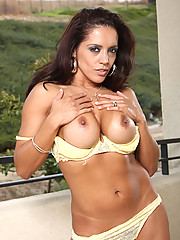 Tanned milf Francesca Le massages lotion into her big tits