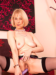 Naked Anilos beauty fondles her mature pink snatch before she masturbates with a purple dildo