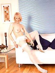 Playful cougar stunner Hazel spreads her pink juice box and drills it hard with a cucumber