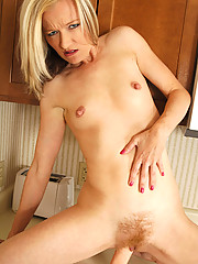 Skinny cougar Heidi Hanson makes her dildo slippery with her mouth and fucks herself in the kitchen