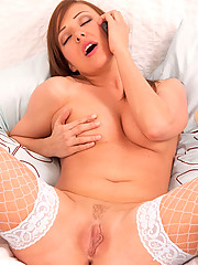 Hot cougar Karen Wood spreads her pussy on her bed while doing having phone sex