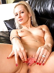 Anilos Laurita flexes her long legs and widely spreads her pink pussy before stuffing it with a toy