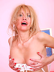 Gorgeous milf stunner Olga gently squeezes her petite boobs before she masturbates with her toy