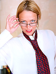 Sultry Anilos Olga is gets much more comfortable as she removes her clothes in the office