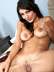 Mature busty Anilos Persia fucks her pussy with a purple toy on the couch