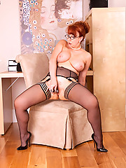 Anilos milf gets horny and stuffs a powerful vibrator in her mature pussy in the office