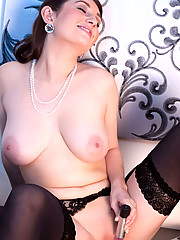 Classy Anilos Tibby shows off her body in sexy pantyhose and starts playing with her unique sex toy