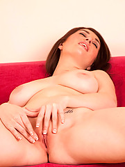 Gorgeous Anilos Tibby exposes her delectable mature tits while caressing her clitoris on the couch
