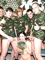 Cute chick jizzed and eats sperm of the army