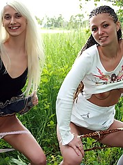 Two hot sexy girls posing naked in the bushes