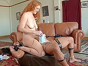 Beautiful redheaded bitch ties up slave boy and fucks his ass
