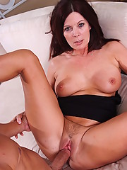 This rich cougar has a little boy toy on the side MILF is very handy with his huge young cock.