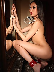 Cute asian babe wearing a muzzle in the nude