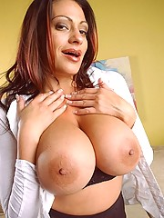 Very busty mom fingers her wet snatch