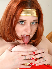 Busty redhead dressed up as Wonder Woman spreads mature pink