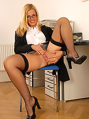 Janet M spreads her mature legs giving a great upskirt shot