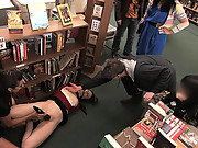Redheaded bookworm gets humilated and fucked in a bookstore