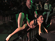 Beautiful brunnette is bound and fucked in a crowded bar