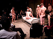 Bobbi Starr, bound, services a roomful of people.