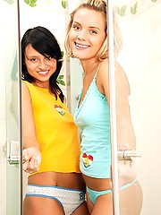 Two horny teenage chicks showering together