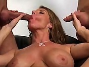 Stacked mature sucks two cocks