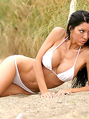 Raquel takes to the beach in a sexy white bikini