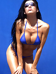 Raquel gets some sun in her blue bikini