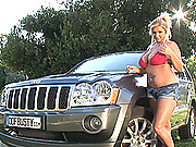 Busty blonde babe Chintia Flowers washing car with big tits