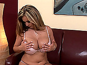 Horny busty babe Constance Devil toying her boobs & pussy