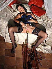 Hot black-haired young babe Abbie Cat on fucking machine