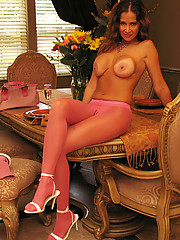 Rio strips down to her pretty pink pantyhose and poses for her fans