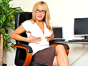 Horny big breasted secretary masturbates in the office