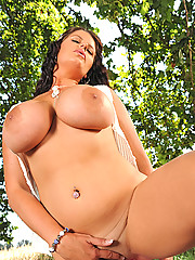 Busty babe Rebecca Jessop playing with her vibrator outdoors