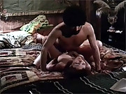 Old retro couple having horny sex on the bed