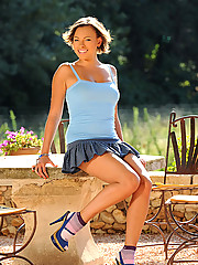 Skye plays outside and shows off her nice legs and feet