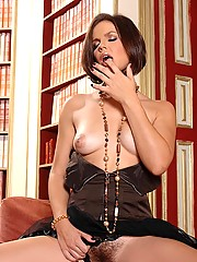 Sexy babe Bobbi Starr stripteasing spreading her pink pussy